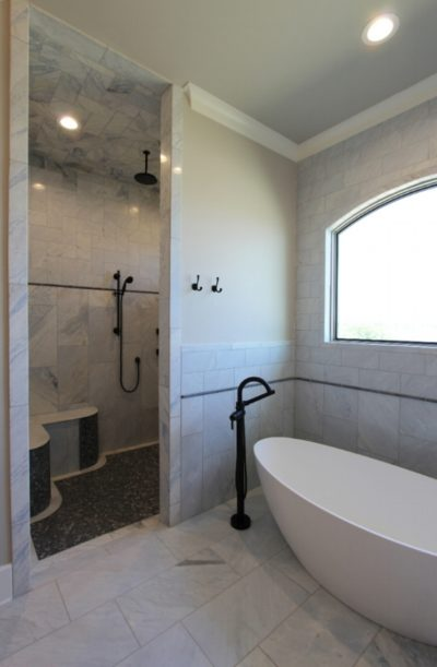 Bathroom with bath and shower view