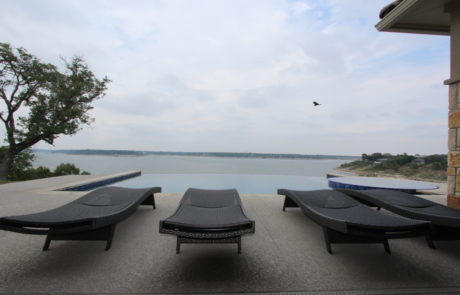 Lounge chairs near pool over Belton Lake